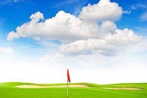 Green golf field blue sky