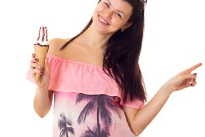 Woman in dress with sunglasses holding ice-cream