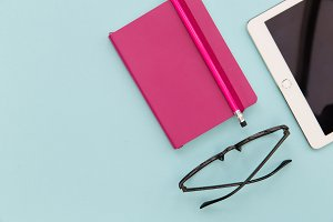 iPad pink notebook + glasses
