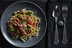 Spaghetti seafood in grey plate on wood table