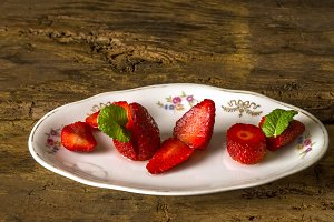 Cut strawberries on plate