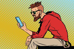 The hipster looks at smartphone