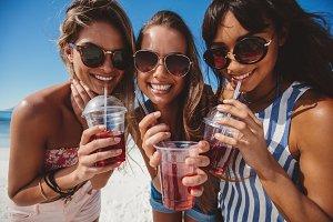 Beautiful young women drinking