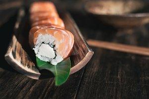 Philadelphia roll on a bamboo plate