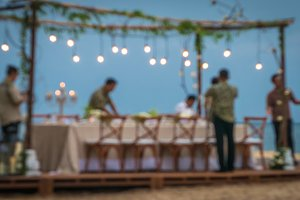 Blurred of Table in the Restaurant witch candles and servants on the Beach, Bali