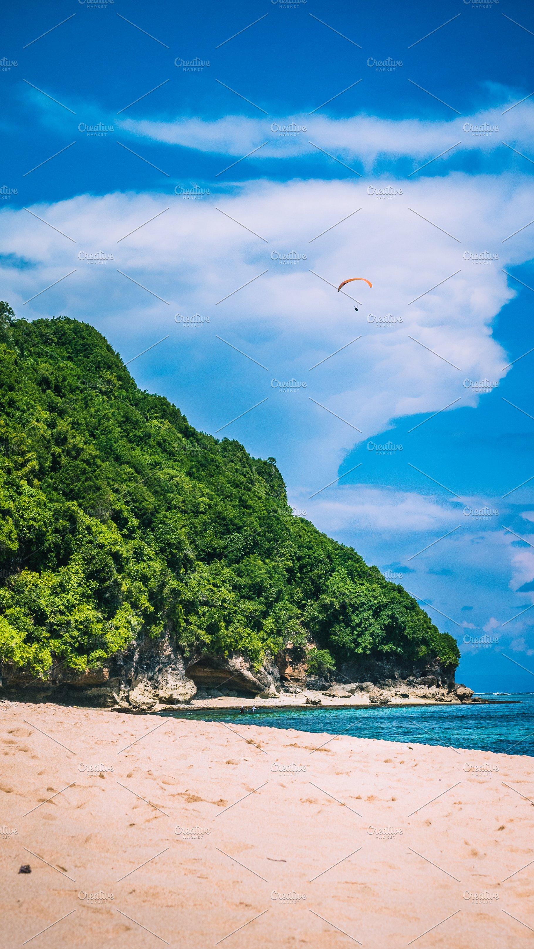 Paraglider Flying Above Pandawa Beach Bali Island Indonesia