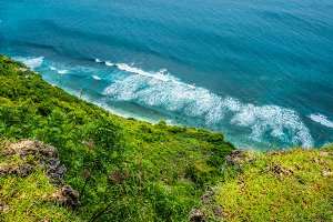 Waves in stunning coastline on Nunggalan Beach, Uluwatu