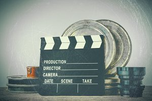 Clapperboard and boxes with film