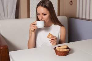 Woman with cookies and tea