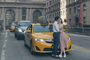 Couple kissing on the yellow Taxi