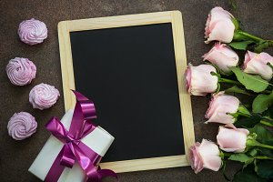 Flower present and  dessert around chalkboard