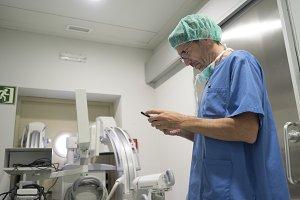 Doctor holding smartphone