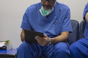 The doctor with the tablet