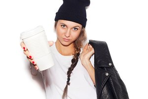 girl in black beanie giving cup