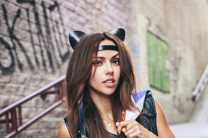 Bad sexy woman with leather cat ears.