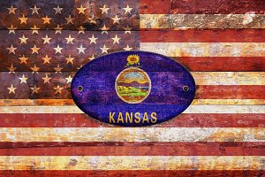 USA and Kansas flags.