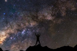 silhouette of man with milky way