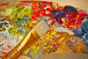 Brush, wood palette and oil paints