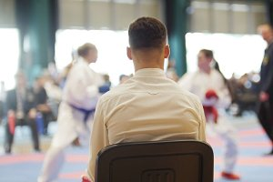 Martial art competitions- karate - cache looks at female teenager's karate fighting