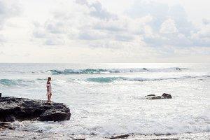 woman on beach of tropic island