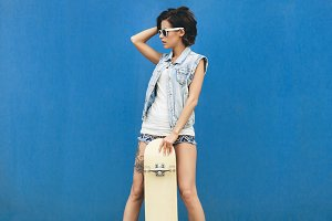 Girl posing with skateboard