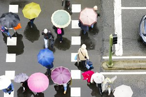 crosswalk with people in rainy day
