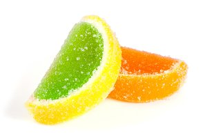 colorful jellies like slices of lemon and orange isolated on white background
