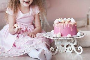 Child girl eating cake