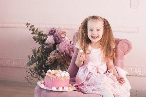 Girl eating cake indoors