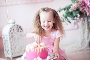 Cute kid girl with cake