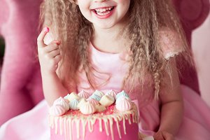 Happy child eating cake