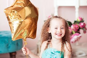 Laughing child with balloon