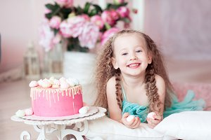 Smiling kid girl with cake