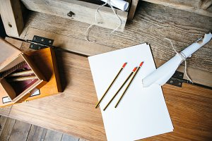 Pencils and paper on wooden table
