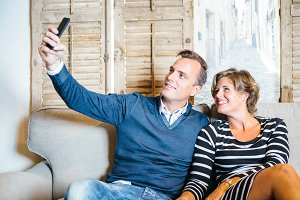 Happy lovers taking selfie with smartphone