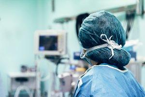 Medical doctor making ECG test.