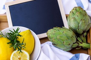 Organic fresh artichokes with lemon