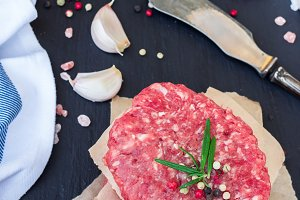 Fresh raw burger cutlets and beaf meat