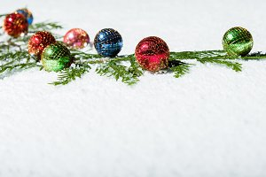 Colorful ornaments in the snow