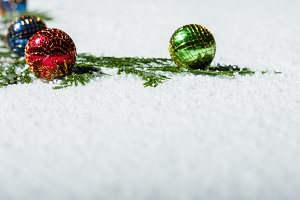 Snow with glass ornaments