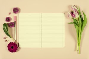 Notebook and flowers