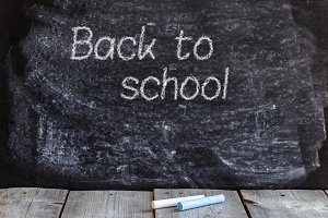 School chalkboard and wooden table