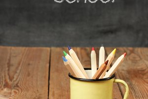 Pencils in a mug on table
