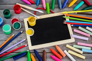 School supplies, crayons, pens, chalk