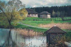 Ethnic houses on rural landscape