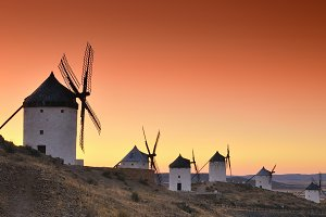 Old windmills at sunset.