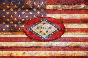 USA and Arkansas flags.