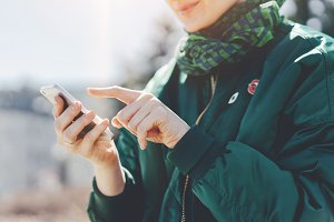 Girl pointing finger on screen phone
