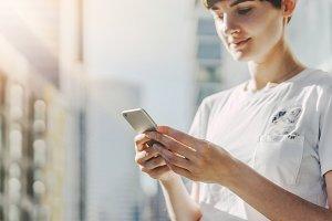 Blogger woman using phone