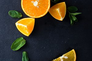 Citrus slices and mint herbs